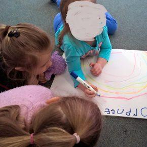 Children drawing a rainbow