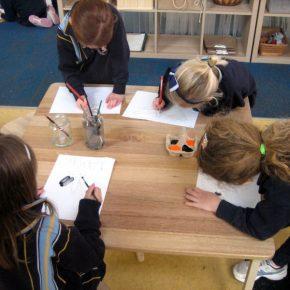 Children painting butterflies