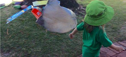 Child running with DIY kite
