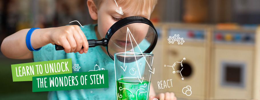 Learn to unlock the wonders of STEM - Boy looking into glass of coloured liquid