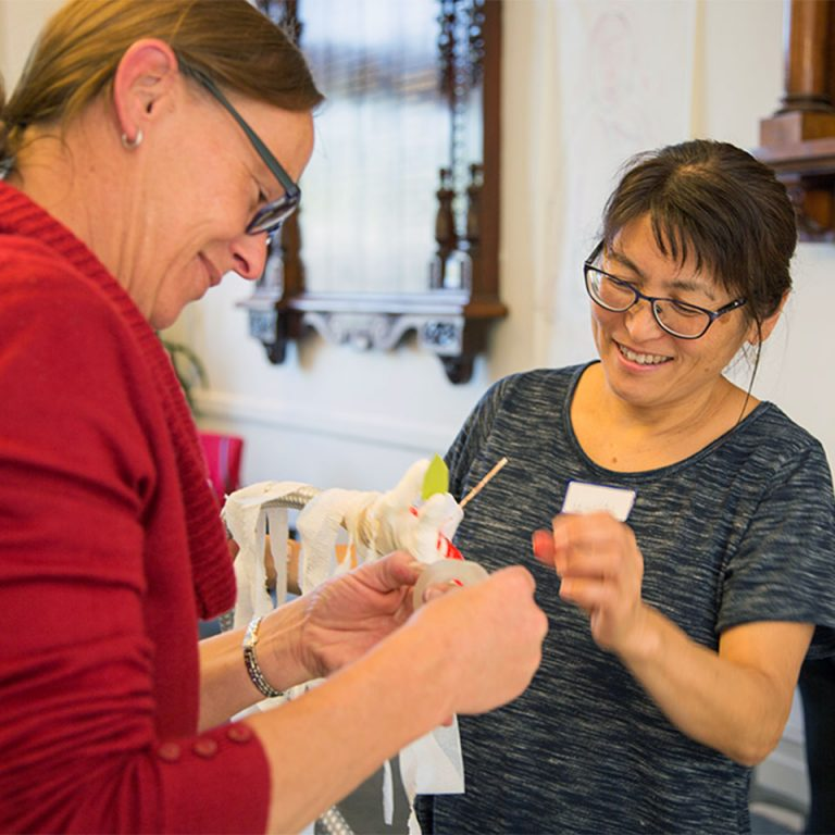 Workshop participants building a model