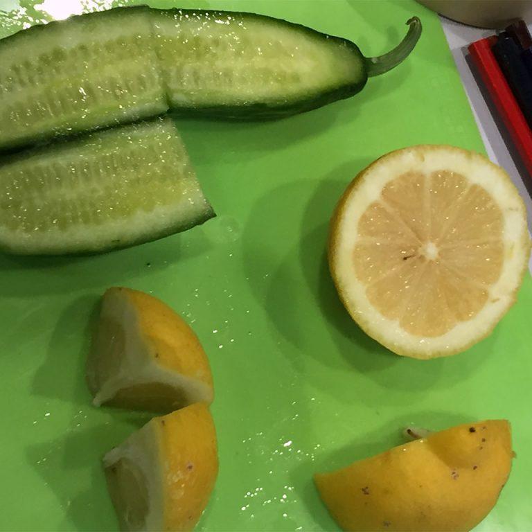 Cucumber and lemons cut cut into halves and quarters