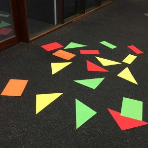 Colourful paper shapes on floor