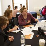 Educators discussing ideas