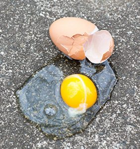 Egg broken on pavement