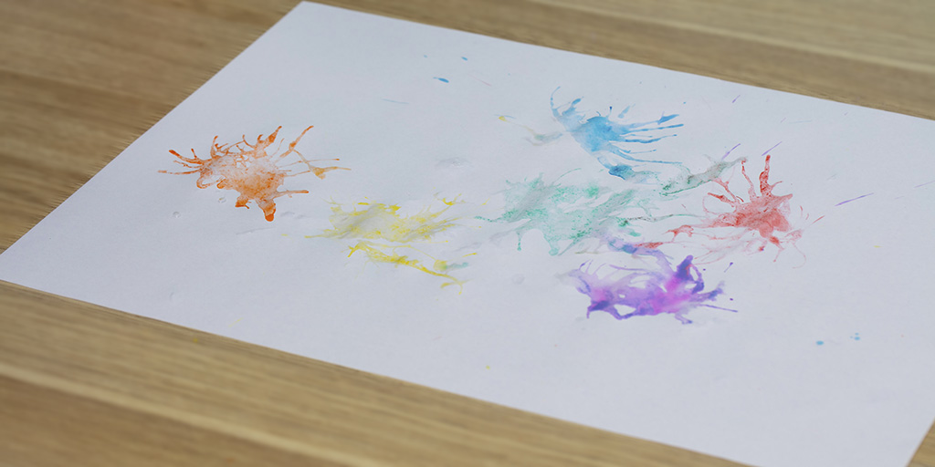 coloured splashes of paint on paper