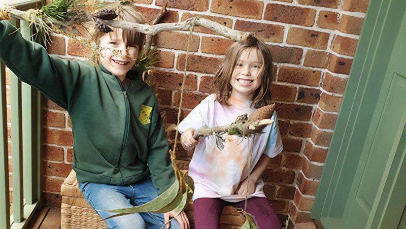 Children holding DIY Wayfinder sticks