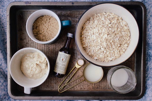 Oats, flour and sugar in measuring cups