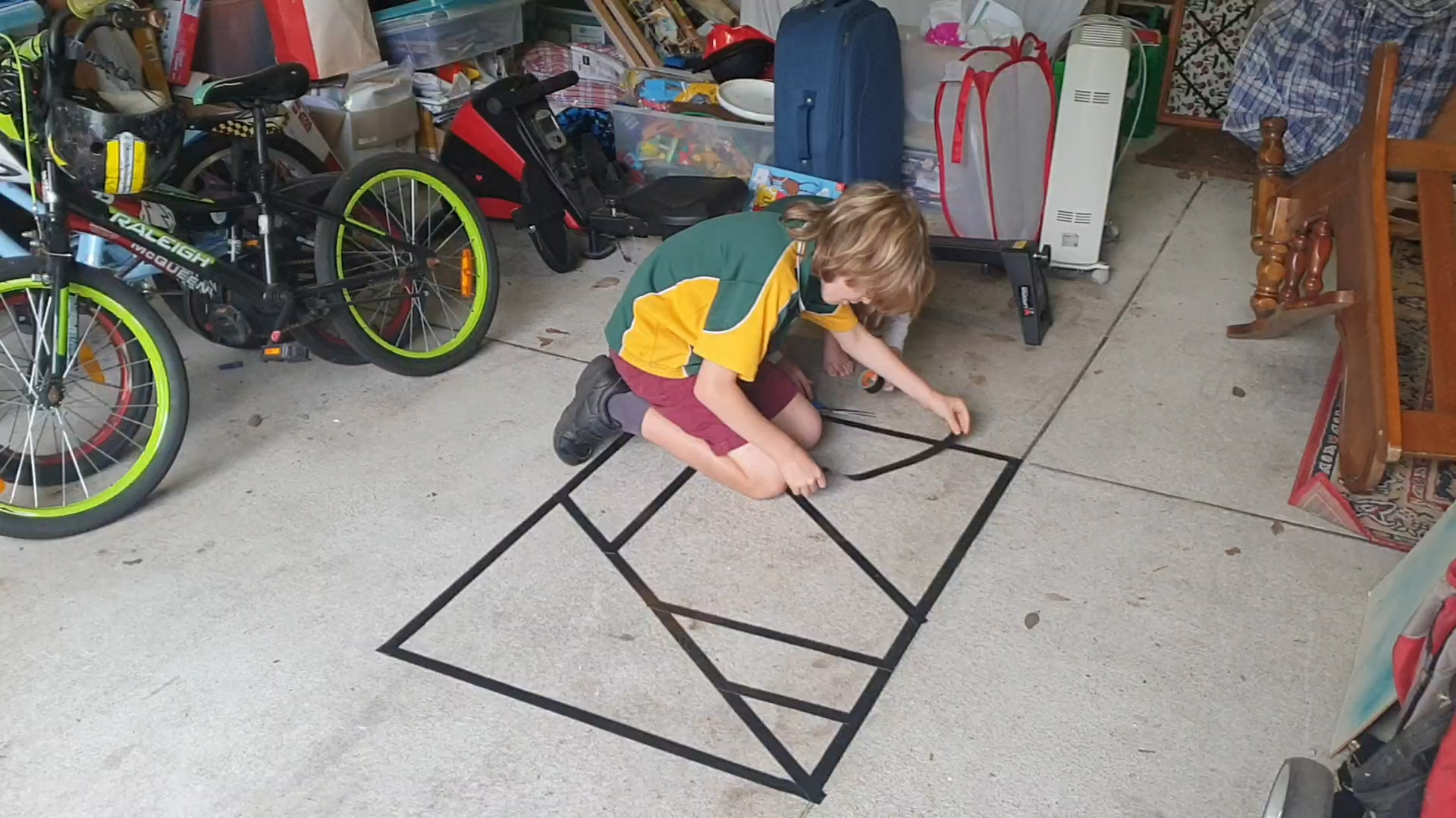 Kids taping floor to make shapes