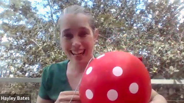 Hayley Bates, early STEM educator with spotted balloon