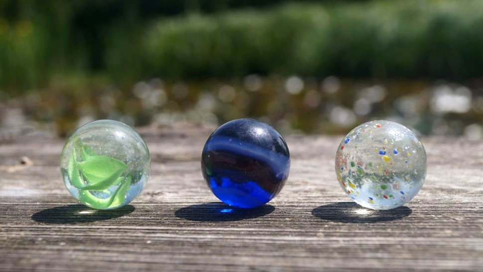 3 marbles on bench