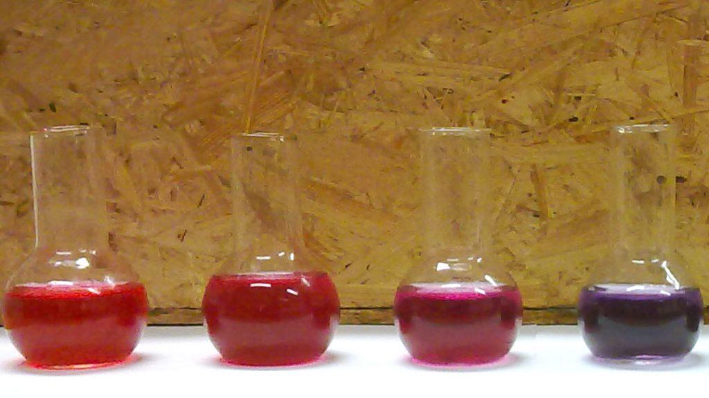 Purple liquids in chemistry flasks