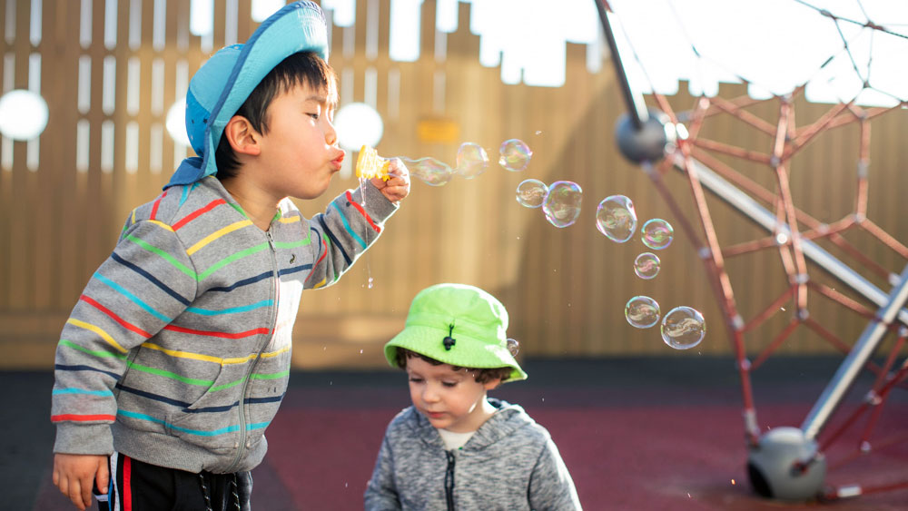 preschool aged boy blowing bubbles