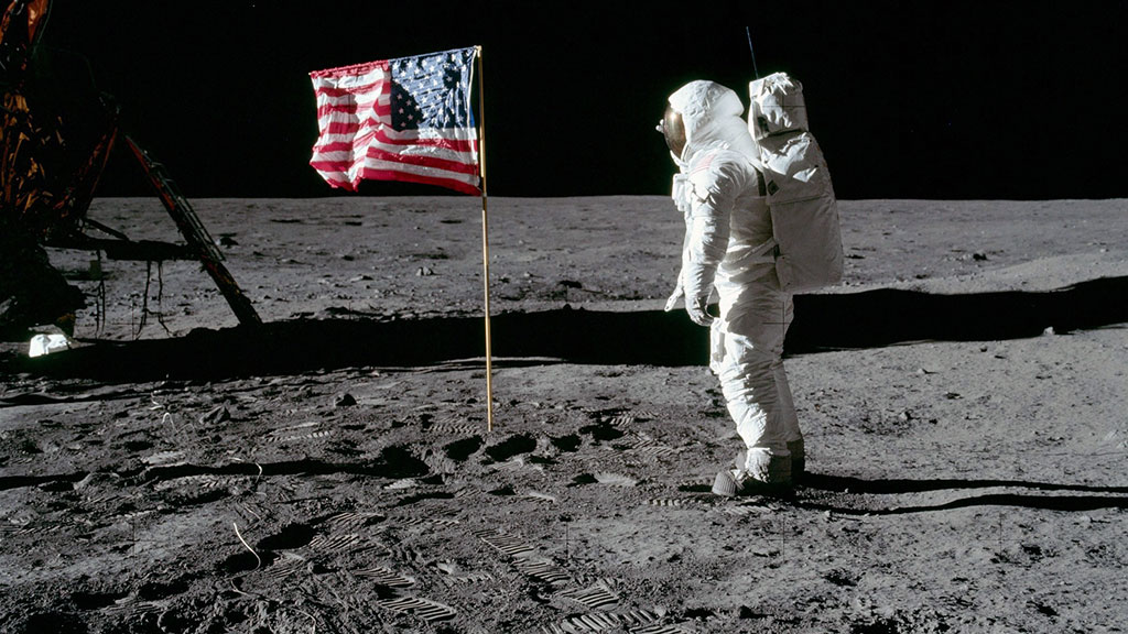Astronaut on moon with American flag erected