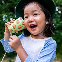 Girl using paper cut as phone