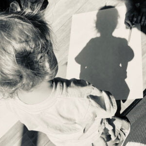Child looking at his body shadow.