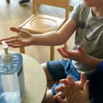 Children using hand sanitiser