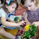 kids looking at flowers