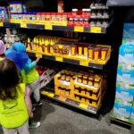 kids looking at honey on shelves